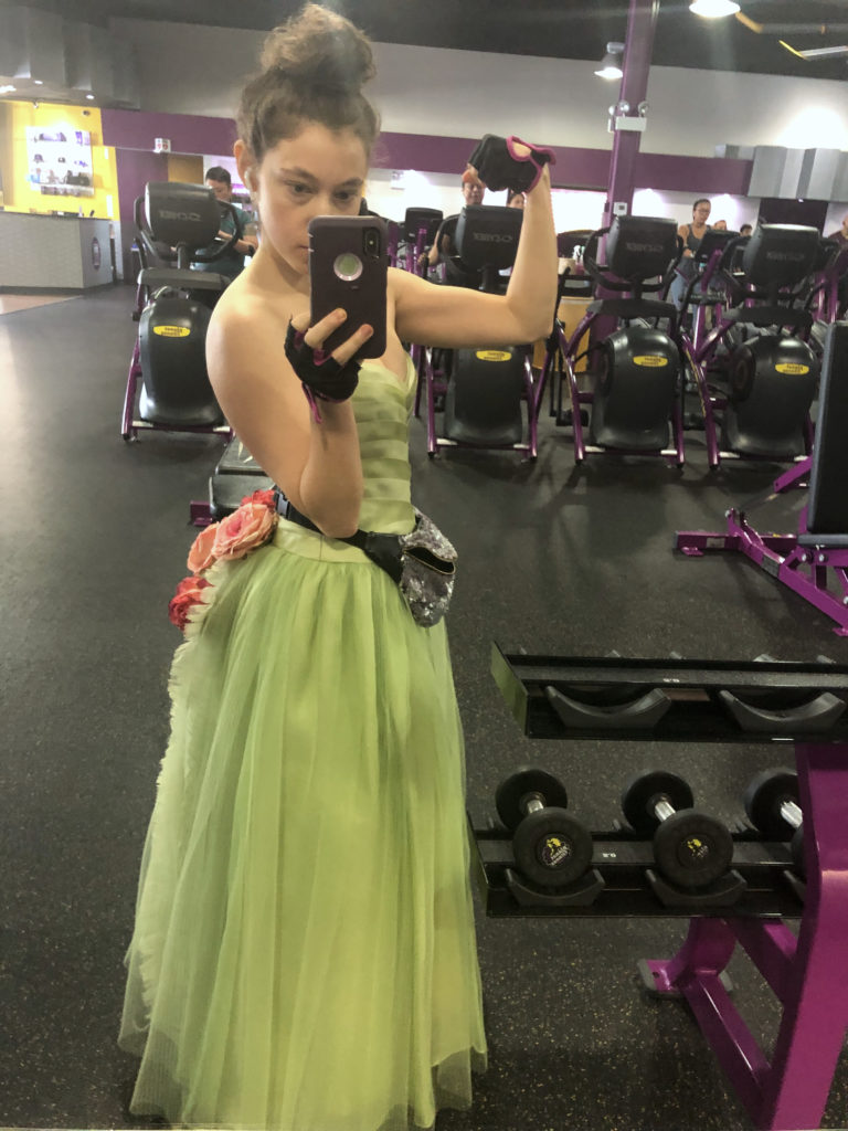 Dashiell Bark-Huss In a gown at Planet Fitness