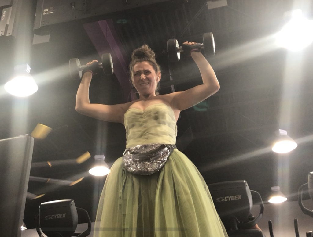 Dashiell Bark-Huss lifting weights in a gown